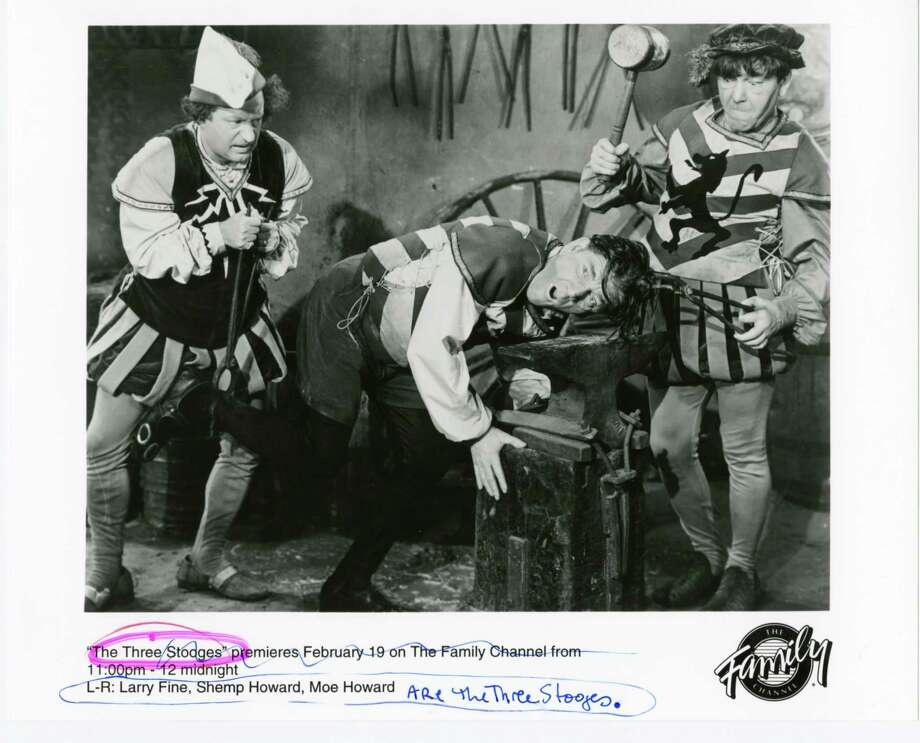 Stooges Larry, left, and Moe, right, beat up on Shemp. Shemp Howard (aka Samuel Horwitz) returned to the act after Curly fell ill. Who is your favorite? Leave an answer at houstonchronicle.com/hoffman. Photo: The Three Stooges