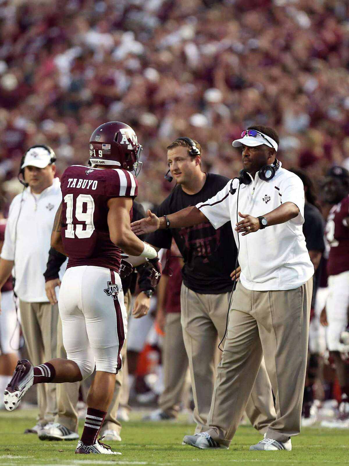 HOUSTON, TX- SEPTEMBER 21: Head coach Kevin Sumlin congratulates his team after scoring against Southern Methodist Mustangs of the Texas A&M Aggies in the second half on September 21, 2013 at Kyle Field in College Station, Texas. (Photo by Thomas B. Shea/Getty Images)
