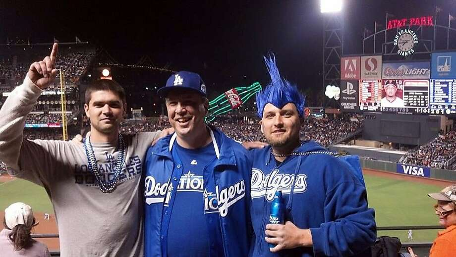 This photo taken on Wednesday, Sept. 25, 2013, and provided by Matthew Gomes, shows, from left to right, Jonathan Denver, his father Robert Preece and his brother Rob Preece at a baseball game between the San Francisco Giants and the Los Angeles Dodgers in San Francisco. Police say Denver was with his father, older brother and two other people a few blocks from the Giants' stadium after leaving the ballpark in the eighth inning of the Giants 6-4 victory when their group exchanged words with some Giants fans. Denver was stabbed to death during the altercation. (AP Photo/Matthew Gomes) Photo: Matthew Gomes, Associated Press
