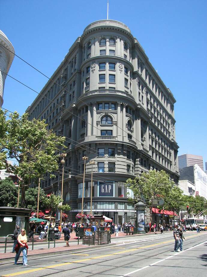 The iconic Flood Building at Powell and Market streets is among 176 commercial buildings in San Francisco that have dramatically reduced energy use in the last five years, according to a report. Photo: John King, The Chronicle
