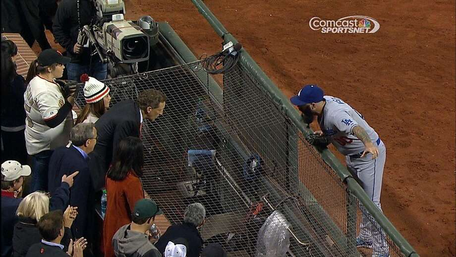 Giants closer Brian Wilson walked to the GiantsÕ side of the field after 3-2 San Francisco victory at AT&T Park on Sept. 26, 2013, as Giants players were shaking hands on the field, to rail on team president Larry Baer for not getting him a 2012 World Series ring. Photo: Courtesy Of Comcast SportsNet