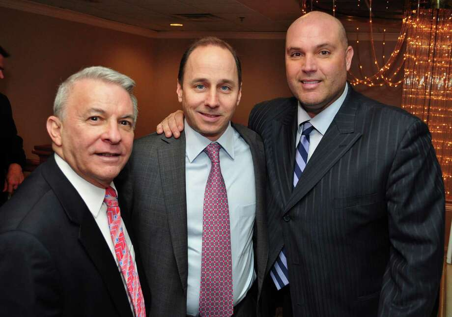 The St. Vincentís SWIM Across the Sound held itís Sports Gala & Auction on Wednesday, January, 19th at Anthonyís Ocean View in New Haven. The featured speakers included Brian Cashman, General Manager of the New York Yankees and Sean Landeta, Former NFL Punter and Super Bowl Champion. (Left to Right): Mike Bisciglia, Vice President of St. Vincentís SWIM Across the Sound Foundation, Brian Cashman, General Manager, New York Yankees and Sean Landeta, Former NFL Punter and Two-Time Super Bowl Champion with the New York Giants. All proceeds from the event will benefit Connecticut Police, Fire, Correction Officers and EMS Personnel and their families battling cancer. Photo: Contributed Photo, ST / Connecticut Post Contributed