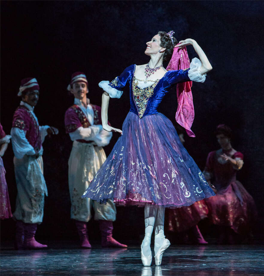 "Mireille Hassenboehler, shown with other artists of Houston Ballet, performs the role of Hanna in ""The Merry Widow"" with joyful energy. In this dream scene, she portrays Hanna as a young peasant girl in love with the artistocrat Danilo. Photo: Amitava Sarkar"