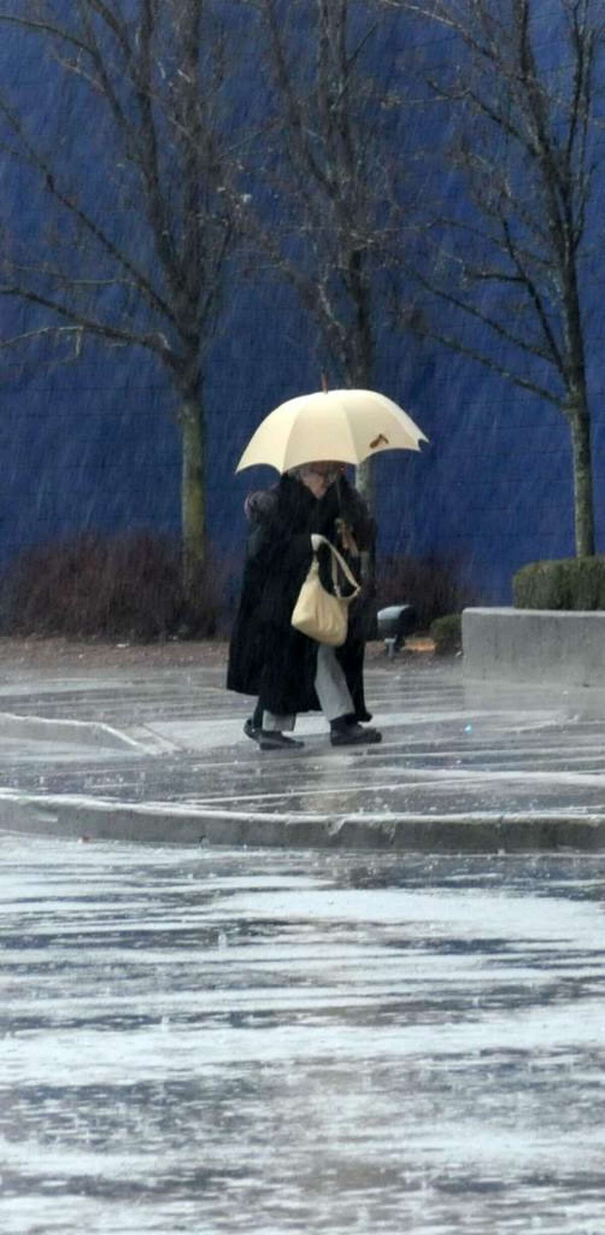 Rain didn't stop this unidentified couple from attending a movie at the AMC Loew's theater, in Danbury, CT, on Monday, Jan. 26, 2010.
