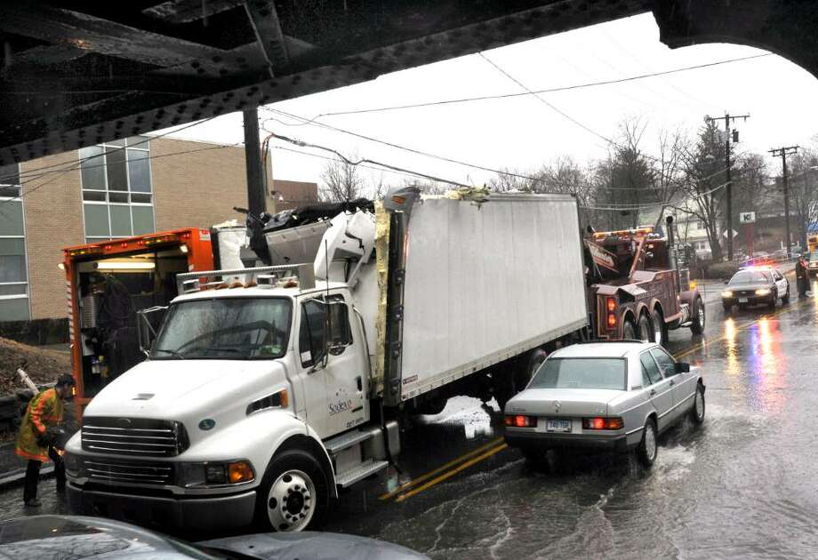 A Truck that failed to clear the West Street Railroad Bridge on Monday, Jan.25,2010, in Danbury. Photo: Michael Duffy / The News-Times