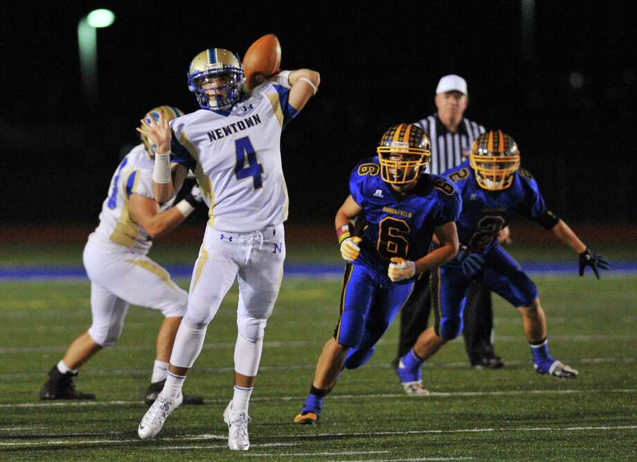 Newtown quarterback Andrew Tarantino (4) throws in the SWC high school football game between Brookfield and Newtown at Brookfield High School in Brookfield, Conn. on Friday, Sept. 27, 2013. Photo: Tyler Sizemore / The News-Times