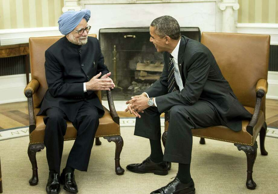 Indian Prime Minister Manmohan Singh and President Barack Obama talk in the Oval Office of the White House. Among the topics touched on were nuclear power, Afghanistan and Pakistan. Photo: Brendan Smialowski / Getty Images