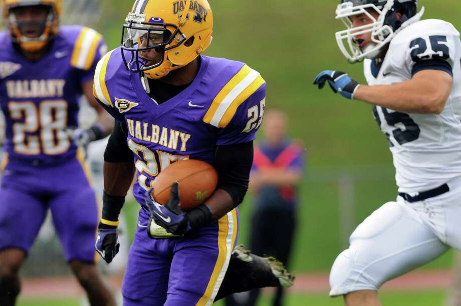 UAlbany's Clay Harris (25), center, gains yards during their football game against Monmouth in a Northeast Conference game on Saturday, Sept. 29, 2012, at UAlbany in Albany, N.Y. (Cindy Schultz / Times Union) Photo: Cindy Schultz / 00019421A