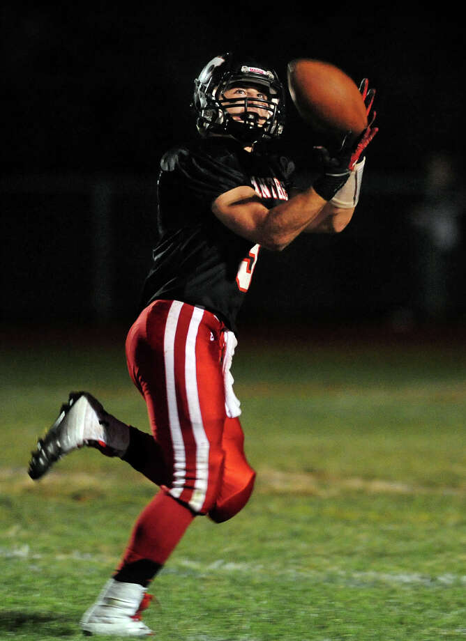 Masuk's PJ Kokkoros completes a pass which he took the endzone for a touchdown, during high school football action against Bunnell in Monroe, Conn. on Friday September 27, 2013. Photo: Christian Abraham / Connecticut Post
