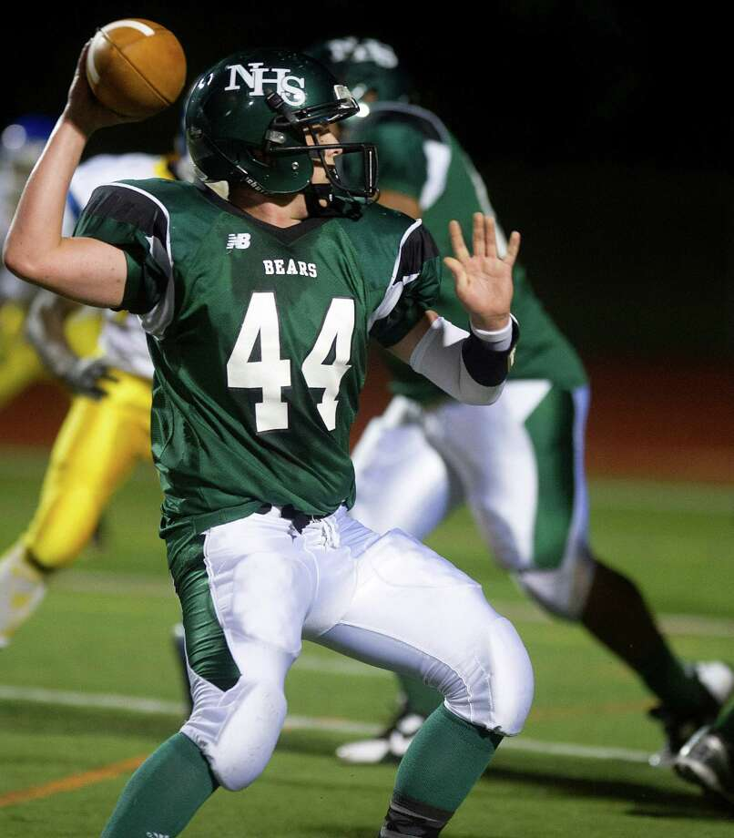 Norwalk's Jared Smith throws the ball during Friday's football game against Harding at Norwalk High School on Sept. 27, 2013. Photo: Lindsay Perry / Stamford Advocate
