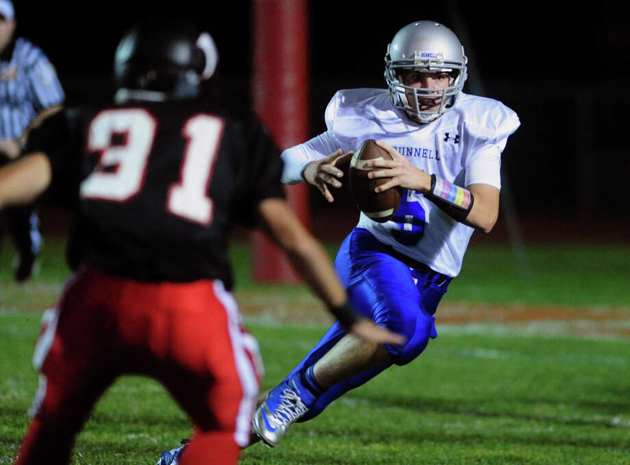 Bunnell QB Nolan Aurelia looks for an opening as he carries the ball, during high school football action against Masuk in Monroe, Conn. on Friday September 27, 2013. Photo: Christian Abraham / Connecticut Post