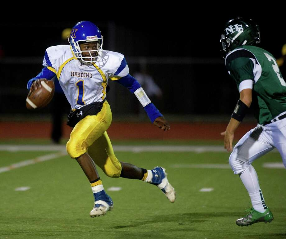 Harding's Christian Hopkins carries the ball during Friday's football game at Norwalk High School on Sept. 27, 2013. Photo: Lindsay Perry / Stamford Advocate