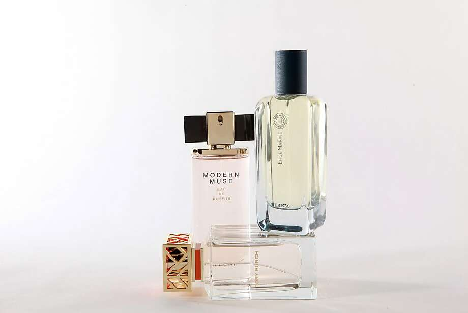 Tory Burch (below), Modern Muse by Estee Lauder (left) and Épice Marine by Hermes. Photo: Liz Hafalia, The Chronicle