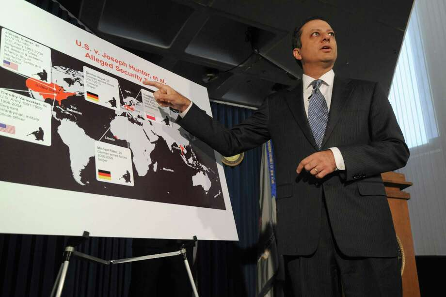 """U.S Attorney for the Southern District Preet Bharara announces the charges against former American soldiers and a former German soldier during a news conference on Friday, Sept. 27, 2013, in New York. Two former American soldiers — one nicknamed """"Rambo"""" — and a German ex-soldier were charged with plotting to kill a U.S. drug enforcement agent and an informant after a law enforcement sting interrupted their plans to use five ex-military snipers to protect illegal drug shipments, authorities said. (AP Photo/Louis Lanzano) ORG XMIT: NYLL103 Photo: Louis Lanzano / FR77522 AP"""