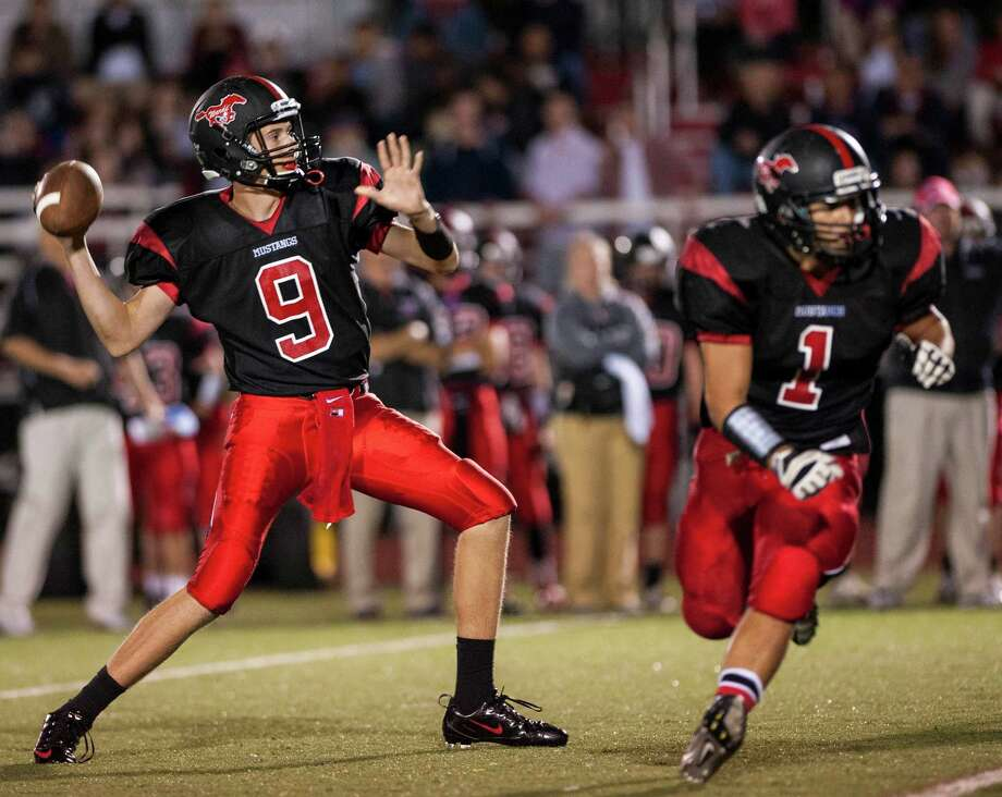 Fairfield Warde high school quarterback Brandon Bisack throwing downfield during a football game against Trinity Catholic high school played at Fairfield Warde high school, Fairfield, CT on Friday, September 27th, 2013. Photo: Mark Conrad / Connecticut Post Freelance