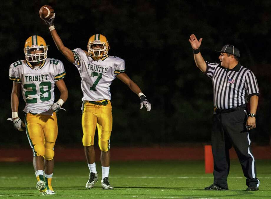 Trinity Catholic high school's Neno Merritt after intercepting a pass during a football game against Fairfield Warde high school played at Fairfield Warde high school, Fairfield, CT on Friday, September 27th, 2013. Photo: Mark Conrad / Connecticut Post Freelance