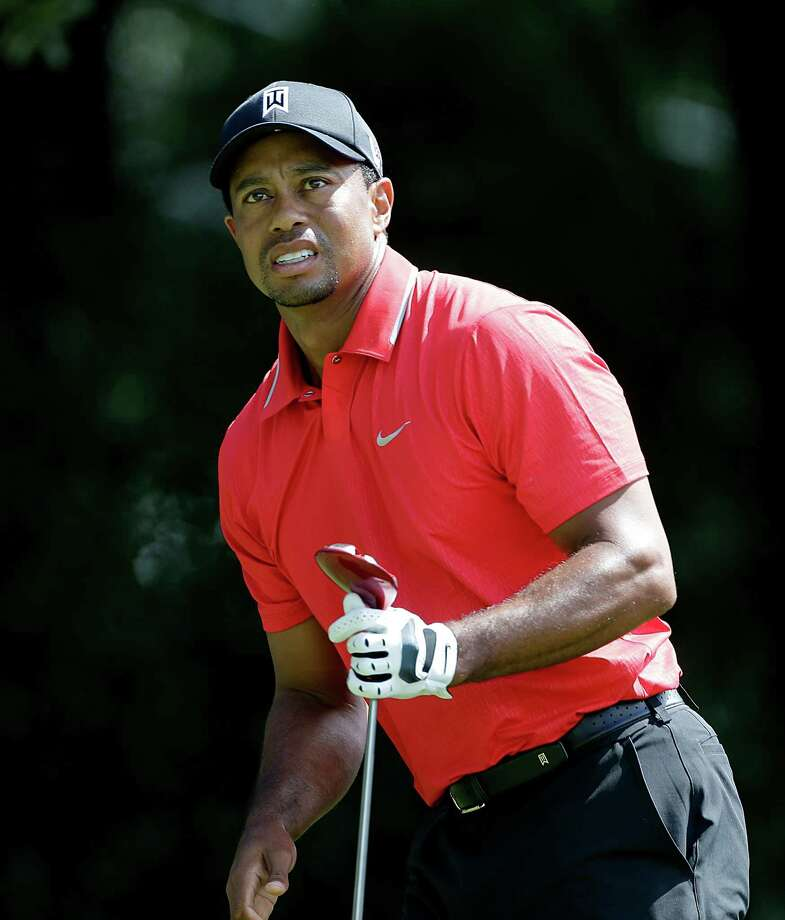 Tiger Woods watching his tee shot off the third hole during the final round of play in the Tour Championship golf tournament at East Lake Golf Club, in Atlanta, Sunday, Sept. 22, 2013. (AP Photo/John Bazemore) ORG XMIT: GAJB103 Photo: John Bazemore / AP