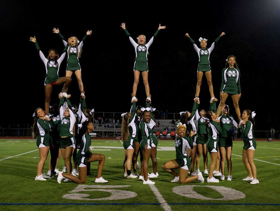 Cheerleaders perform during Friday's football game at Norwalk High School on Sept. 27, 2013. Photo: Lindsay Perry / Stamford Advocate