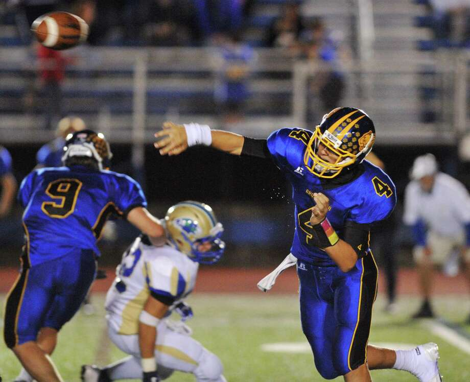 Brookfield quarterback Brad Westmark throws during the SWC high school football game between Brookfield and Newtown at Brookfield High School in Brookfield, Conn. on Friday, Sept. 27, 2013. Photo: Tyler Sizemore / The News-Times