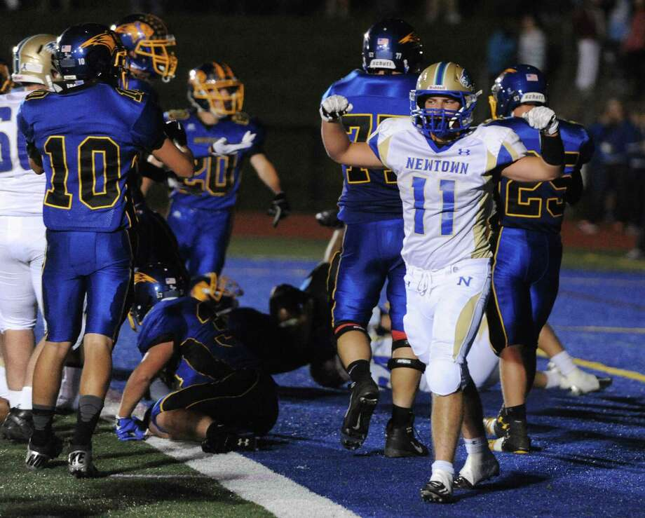 Newtown's Cooper Gold (11) celebrates after scoring a touchdown in the SWC high school football game between Brookfield and Newtown at Brookfield High School in Brookfield, Conn. on Friday, Sept. 27, 2013. Photo: Tyler Sizemore / The News-Times