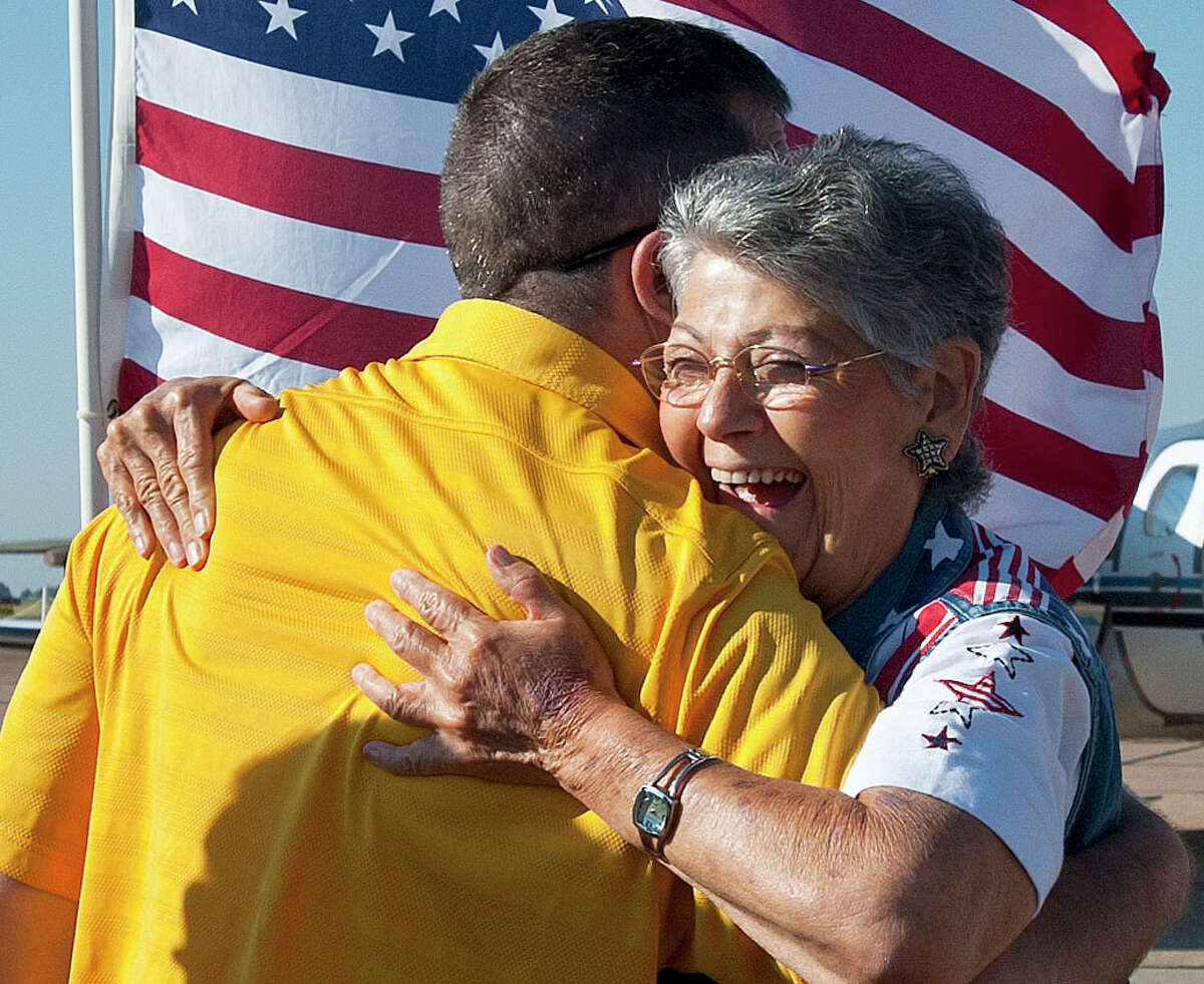 Joyce Shutt hugs retired Army Lt. Col. Kurt Kosmatka of Parma, Ohio, at the Wounded Warriors arrival at the Tyler Pounds Airport Jet Center in Tyler, Texas on Friday, Sept. 27, 2013. Shutt is a member of Welcome Home Soldiers, an organization that provides flag lines, cheers and smiles to military members arriving in the Tyler-Longview area.