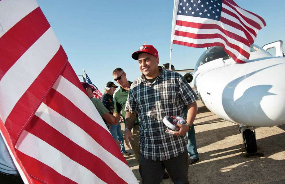Army Sgt. Ernesto Ramirez of Yuma, Ariz. is greeted at the Wounded Warriors arrival at the Tyler Pounds Airport Jet Center in Tyler, Texas on Friday, Sept. 27, 2013. Photo: Sarah A. Miller, Associated Press / Tyler Morning Telegraoh