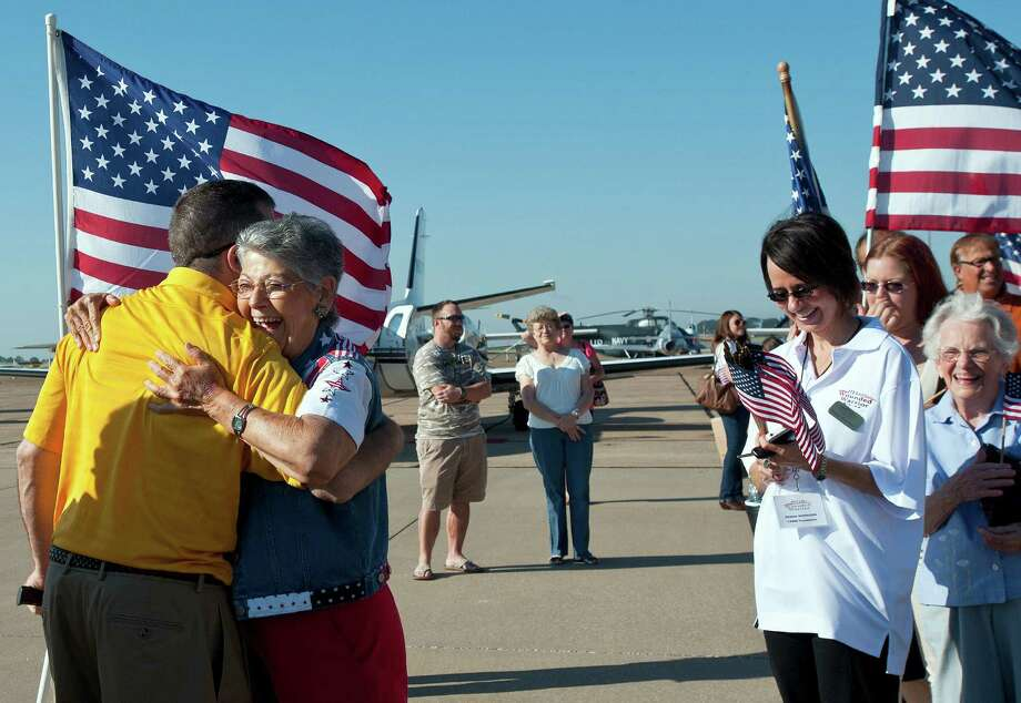 Joyce Shutt hugs retired Army Lt. Col. Kurt Kosmatka of Parma, Ohio, at the Wounded Warriors arrival at the Tyler Pounds Airport Jet Center in Tyler, Texas on Friday, Sept. 27, 2013. Shutt is a member of Welcome Home Soldiers, an organization that provides flag lines, cheers and smiles to military members arriving in the Tyler-Longview area. Photo: Sarah A. Miller, Associated Press / Tyler Morning Telegraoh