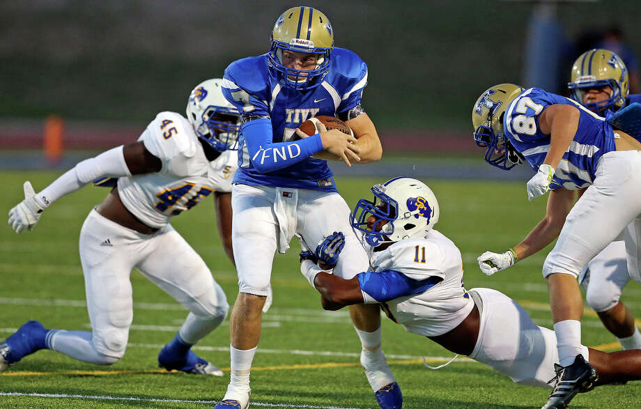 Antler quarterback Ryon Mays is brought down by Buffalo linebacker  Matthew Johnson as Clemens defensive end Kolin Hill moves in as teammate Tivy hosts Clemens at Antler Stadium in Kerrville  on September 27, 2013 Photo: TOM REEL, San Antonio Express-News / San Antonio Express-News