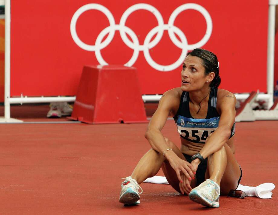 After recuperating from a nightmarish car accident involving an 18-wheeler in February 2007, Hunter-Galvan appealed to a New Zealand spots tribunal for a spot on the 2008 Olympic team. She won the appeal,  ran for her native country in the Olympics for the second time,  and finished 35th out of 82 runners in 2 hours,  34 minutes and 51 seconds in Beijing. She also finished second in the inaugural San Antonio Rock 'n' Roll Marathon & Half Marathon in a personal best 2:29:37 on Nov. 16. Photo: Mark Dadswell, Getty Images / 2008 Getty Images