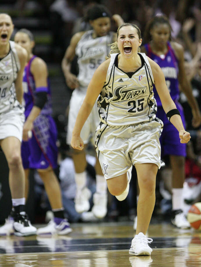 Behind her,  the Silver Stars engineered their first winning season and won their first playoff series and filled the AT&T Center with more than 15,000 dizzy fans for their Western Conference finals opener against Phoenix. Photo: Delcia Lopez, Associated Press / AP