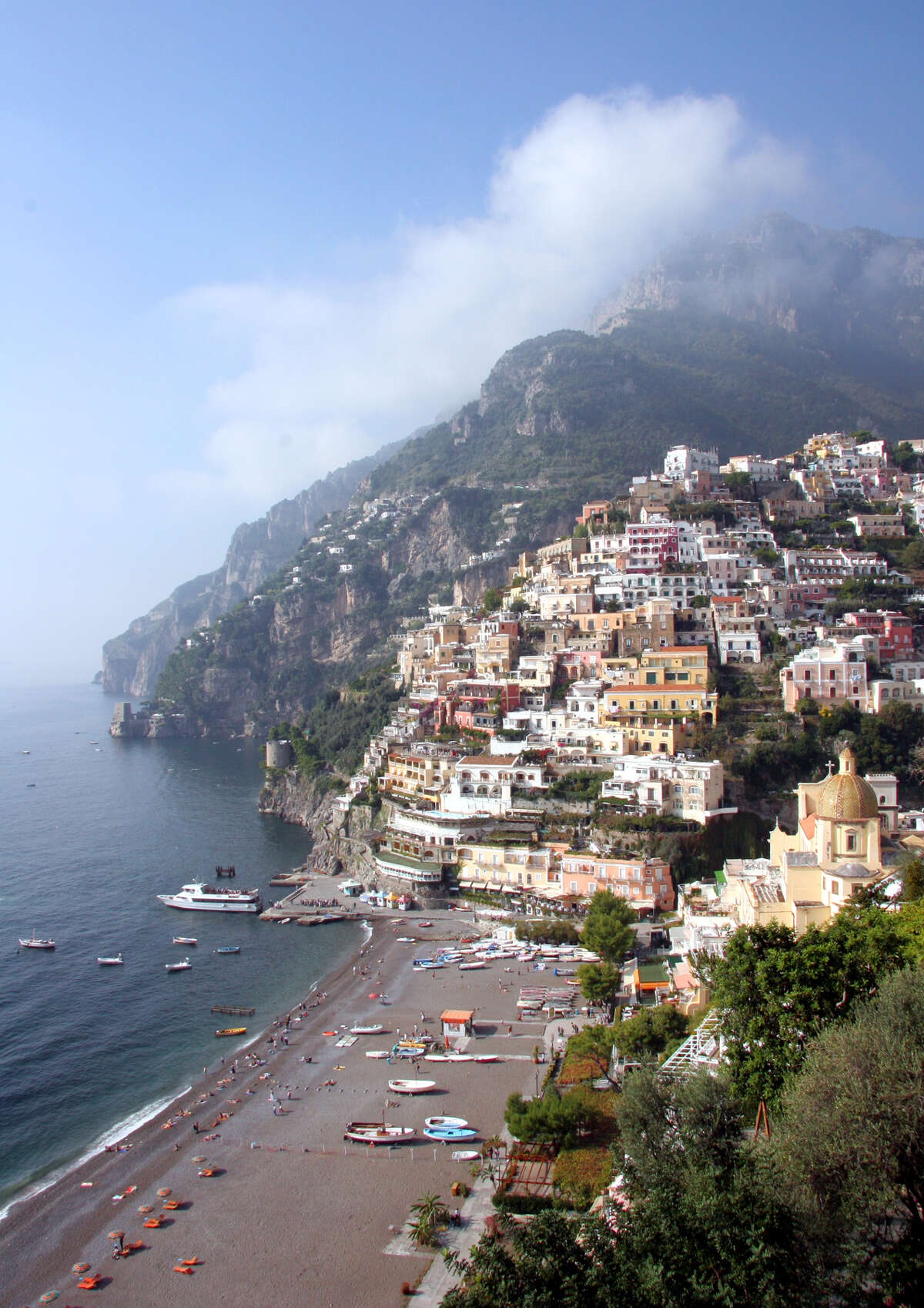 Specializing in scenery and sand, Positano scrambles down a cliff halfway between Sorrento and Amalfi town. (photo: Pat O'Connor)