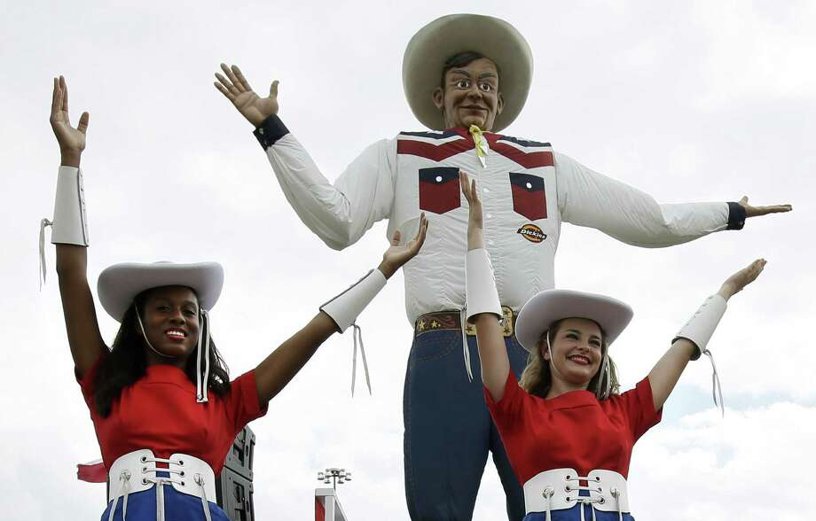 """Dallas' Big Tex, the 55 foot tall cowboy at the State Fair grounds, is currently in a competition to see what is the """"Best Quirky Landmark."""" Click ahead to see some of San Antonio's odd attractions, including dead animals, big shoes and big food."""