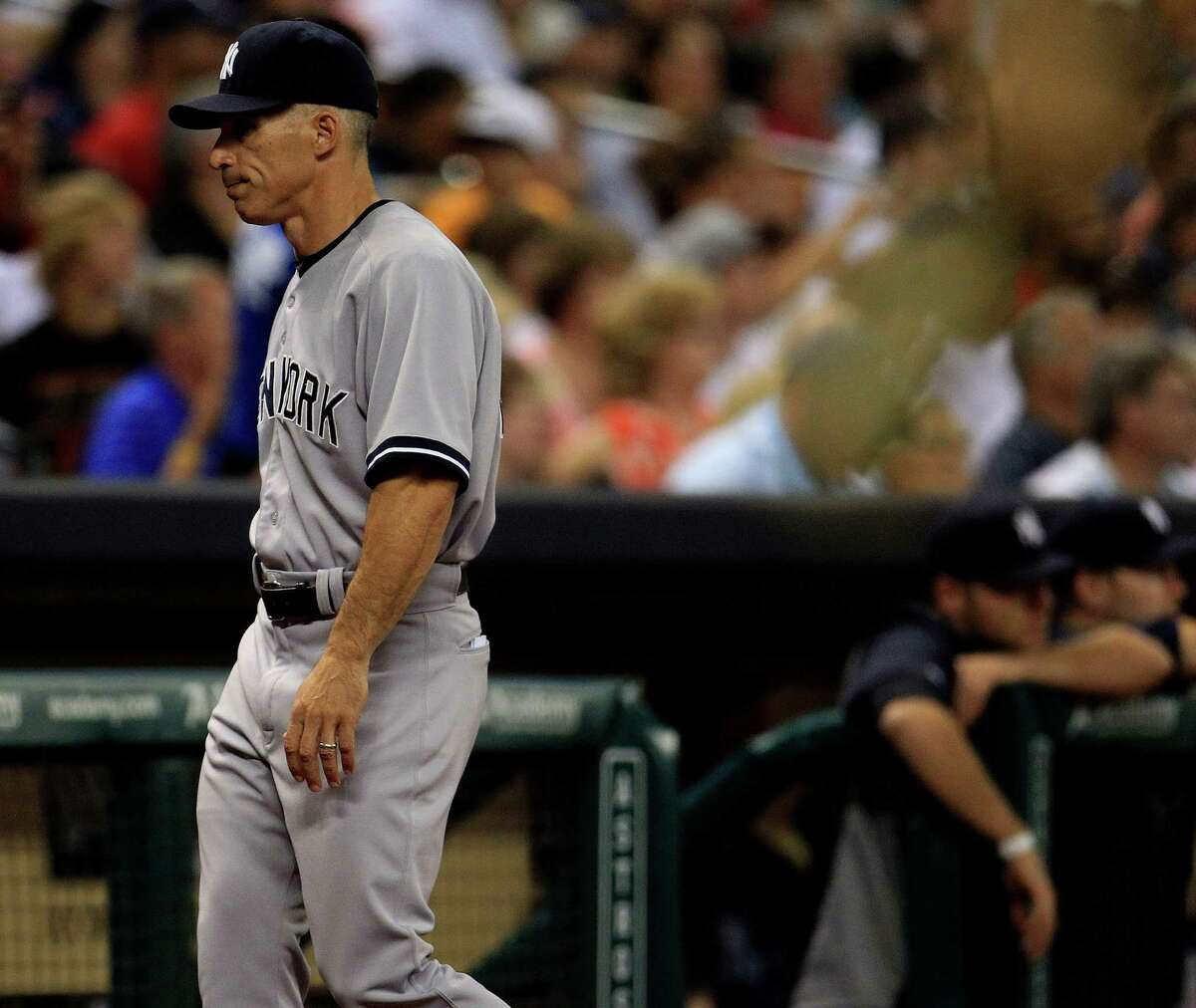 New York Yankees manager Joe Girardi (28) walks back to the dugout during the sixth inning of a MLB game at Minute Maid Park, Friday, Sept. 27, 2013, in Houston.