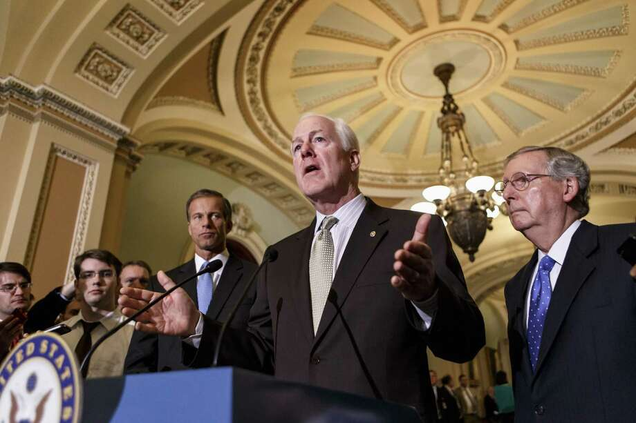 Senate Minority Whip John Cornyn (center), flanked by Senate Minority Leader Mitch McConnell (right) and Sen. John Thune, were among those who broke with Ted Cruz's hardball tactics. Photo: J. Scott Applewhite / Associated Press