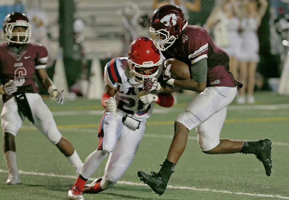 9/27/13: Clear Creek's Kaliq Kokuma #4 runs over Clear Lake's Andre Gaskin #20 for a rushing touchdown in a high school football game at Veterans Memorial Stadium in League City, Texas. Photo: Thomas B. Shea, Houston Chronicle / © 2013 Thomas B. Shea