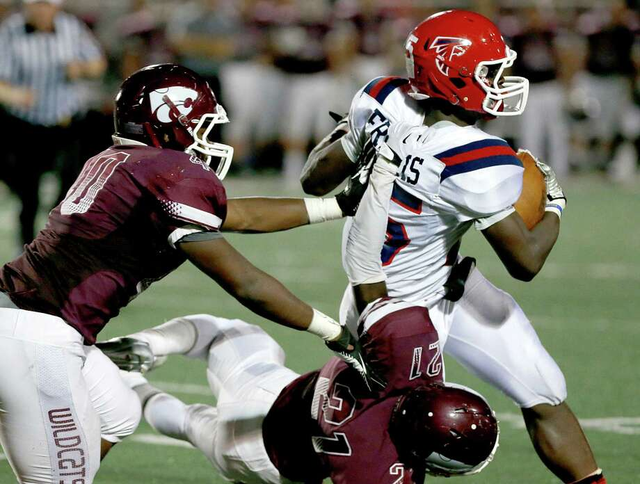 9/27/13: Clear Lake's Deshon Francis #25 is tackled by Clear Creek's Ben Sutton #21 in a high school football game at Veterans Memorial Stadium in League City, Texas. Photo: Thomas B. Shea, Houston Chronicle / © 2013 Thomas B. Shea