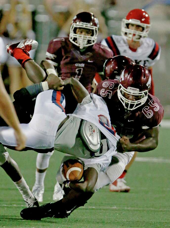 9/27/13:  Clear Lake's Deshon Francis #25 is tackled and thrown upside down by Clear Creek defender in  a high school football game at Veterans Memorial Stadium in League City, Texas. Photo: Thomas B. Shea, Houston Chronicle / © 2013 Thomas B. Shea