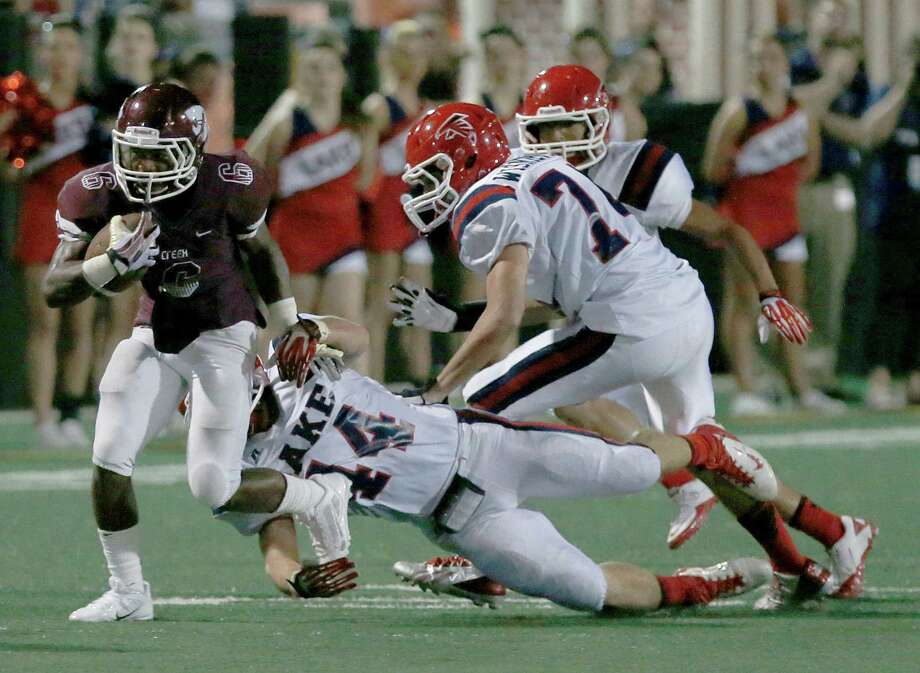 9/27/13:  Clear Creek's Davon Smith #6 breaks the tackle of Clear Lake's   Landon LaBrier Sean Fortney #14 in a high school football game at Veterans Memorial Stadium in League City, Texas. Photo: Thomas B. Shea, Houston Chronicle / © 2013 Thomas B. Shea