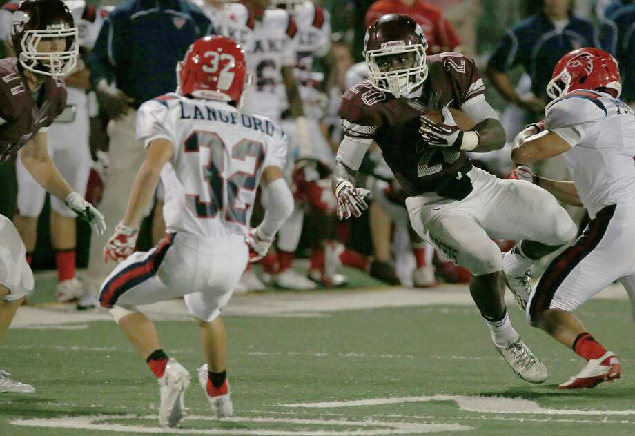 9/27/13:  Clear Creek's CJ Green #20 breaks tackles and dives against Clear Lake in  a high school football game at Veterans Memorial Stadium in League City, Texas. Photo: Thomas B. Shea, Houston Chronicle / © 2013 Thomas B. Shea