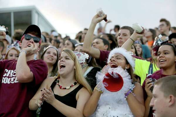 9/27/13: Clear Creek fans cheer while Clear Lake play against Clear Creek in a high school football game at Veterans Memorial Stadium in League City, Texas.