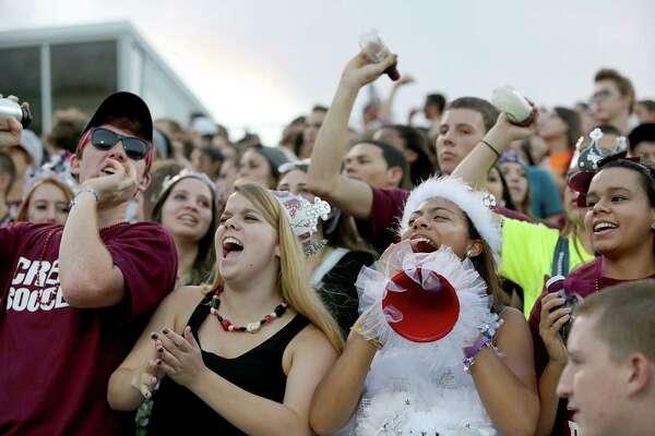 9/27/13: Clear Creek fans cheer while Clear Lake play against Clear Creek in a high school football game at Veterans Memorial Stadium in League City, Texas.