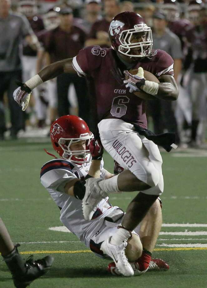 9/27/13:  Clear Creek's Davon Smith #6 breaks the tackle of Clear Lake's   Landon LaBrier #15 in a high school football game at Veterans Memorial Stadium in League City, Texas. Photo: Thomas B. Shea, Houston Chronicle / © 2013 Thomas B. Shea