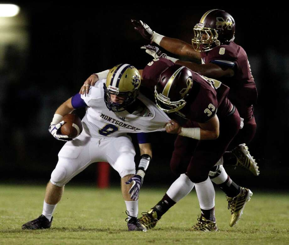 Montgomery's Frankie Philliops (8) is tackled by Magnolia West's Luke Knowles (33)  during the first half of a high school football game, Friday, September 27, 2013 at Mustang Stadium in Magnolia. Photo: Eric Christian Smith, For The Chronicle
