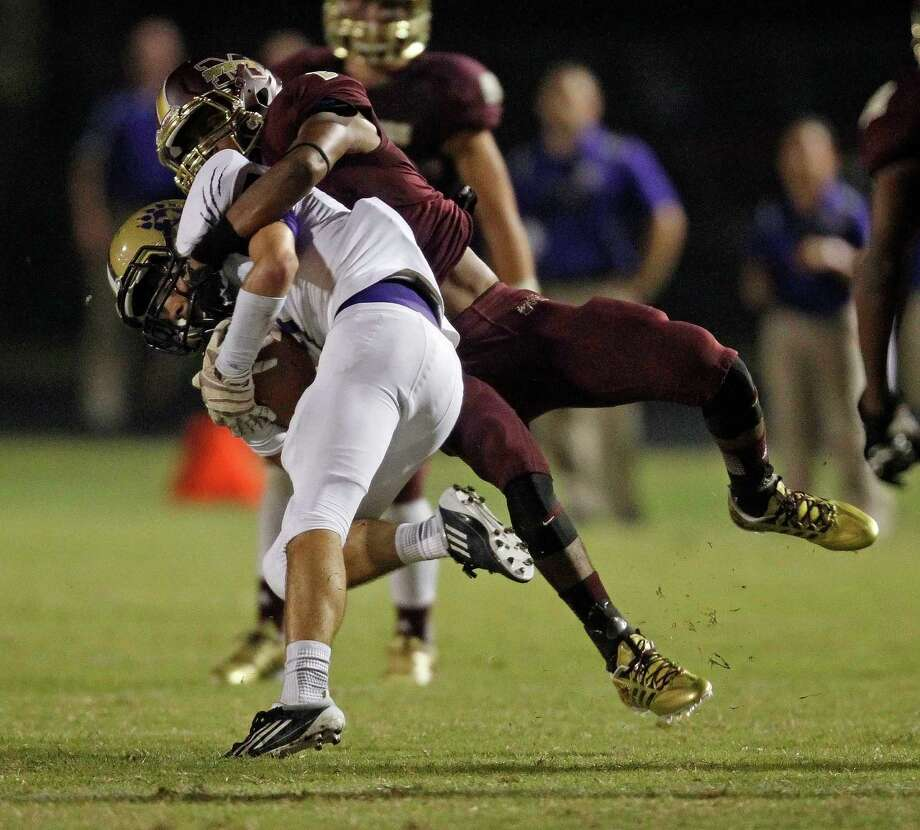 Montgomery's Austin Champion, left, is tackled by Magnolia West's Damarren Reese during the first half of a high school football game, Friday, September 27, 2013 at Mustang Stadium in Magnolia. Photo: Eric Christian Smith, For The Chronicle