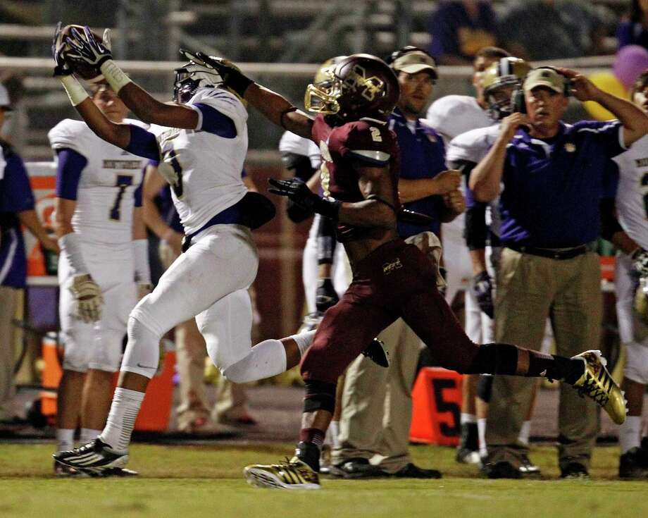 Montgomery's Ken'dre Howard, left, makes a reception past Magnolia West's Damarren Reese during the first half of a high school football game, Friday, September 27, 2013 at Mustang Stadium in Magnolia. Photo: Eric Christian Smith, For The Chronicle