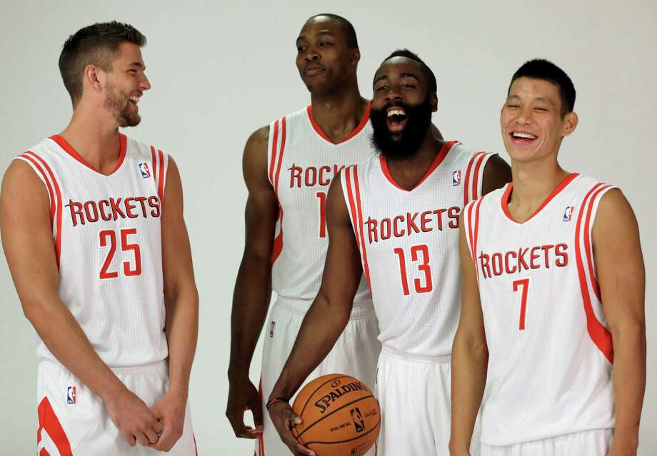 Dwight Howard, center-left, has delivered plenty of smiles to his new teammates, and once the season starts, Chandler Parsons (25), James Harden (13) and Jeremy Lin (7) and the rest of the Rockets will look to him to help deliver a postseason run. Photo: David J. Phillip, STF / AP