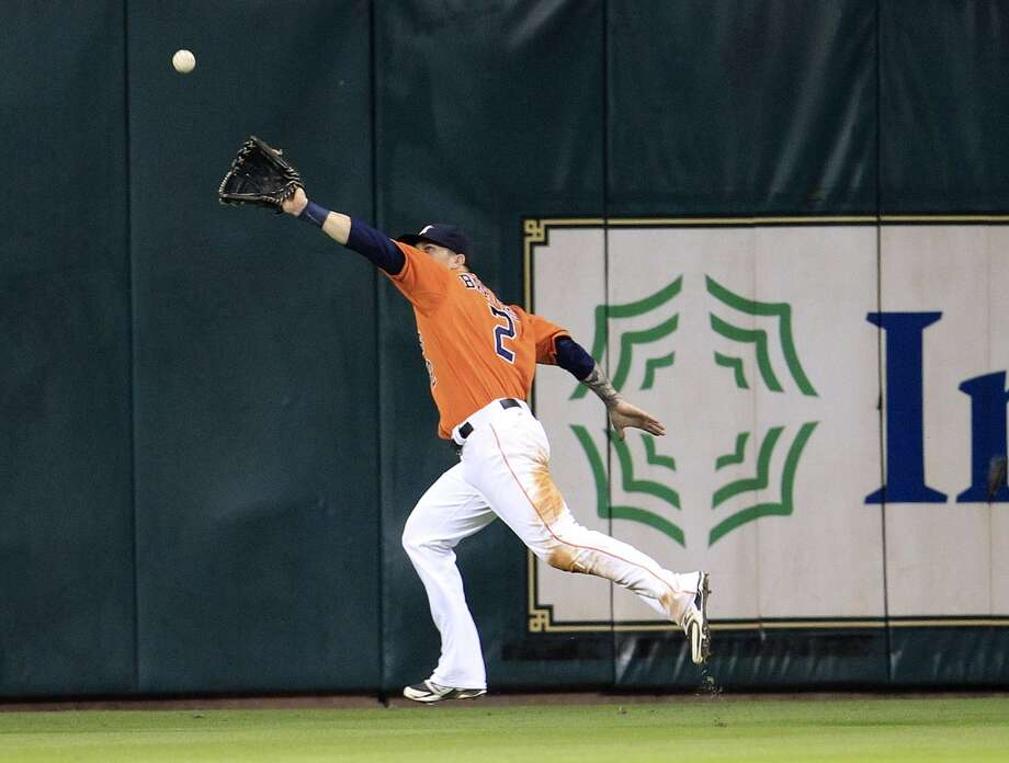 Sept: 27: Yankees 3, Astros 2 Astros center fielder Brandon Barnes (2) reaches out to make the catch on a fly ball by Eduardo Nunez. Photo: Karen Warren, Houston Chronicle