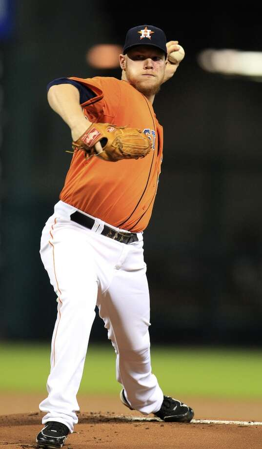 Astros starting pitcher Brett Oberholtzer (65) pitches. Photo: Karen Warren, Houston Chronicle