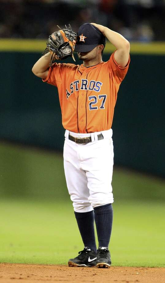 Astros second baseman Jose Altuve (27) adjusts his cap. Photo: Karen Warren, Houston Chronicle