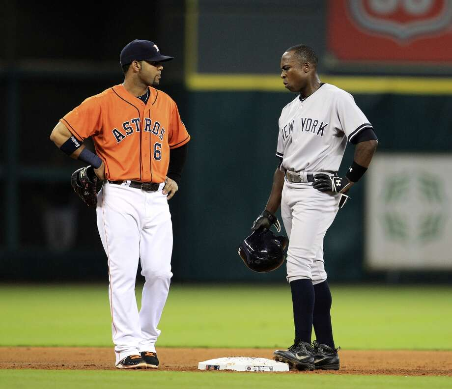 Yankees left fielder Alfonso Soriano (12) chats with Astros shortstop Jonathan Villar (6) as he stands on second base while his double was reviewed. Photo: Karen Warren, Houston Chronicle
